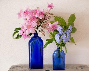 conjunto de frascos vintage azul