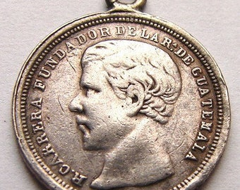1869 GUATEMALA SILVER CHARM Carrera Guatemala president and Arms 1/2 Real Silver coin Charm