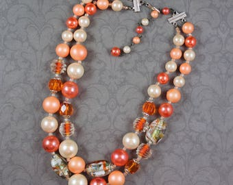 Vintage 1950s to 1960s Double Strand Orange, Peach, White and Silver Plastic and Glass Beaded Necklace