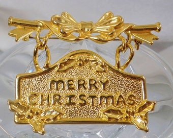 SALE Vintage Merry Christmas Swinging Banner Brooch.  AJC. Gold Dangling Merry Christmas Pin.  Holiday Pin. Holly and Bow Banner Brooch.