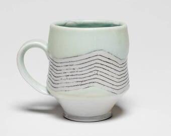 Wave soda fired porcelain mug
