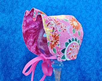 Reversible Pink Baby Bonnet with Flowers