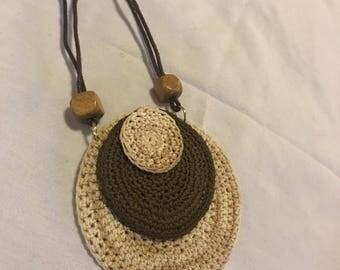 Crocheted disc pendant