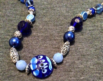 OOAK Blues Galore Necklace, handmade SRA lampwork bead focal glass crystals silver beads cats eyes