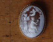 Antique Victorian 9 CT large shell cameo with cherub and ladies