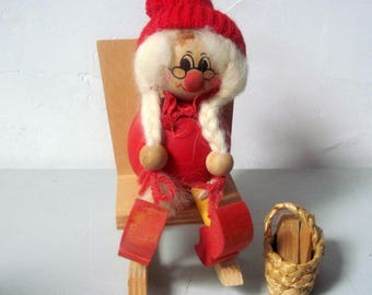 Vintage wooden woman doll in rocking chair made Sweden