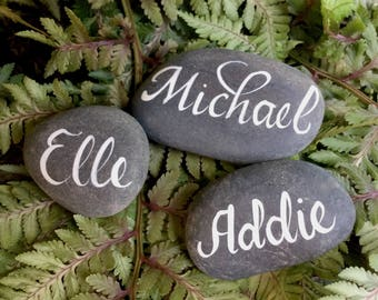hand lettered pebbles for weddings, personalized rocks