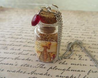 Apothecary Jar Of Bone Dust With Glass Heart Necklace
