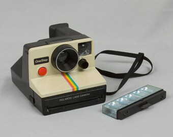 Polaroid One Step Instant Land Camera with flash SX 70 Film Made in the USA White front Rainbow stripe Pristine Flash bar