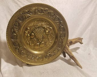 Vintage pair of wall hanging Embossed brass plates