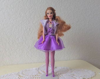 Candi Girl Fashion Doll from the Hamilton Design System, 1990 Wearing a Barbie Fashion Avenue Party Outfit.