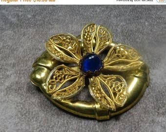 25% Off Brass and Plastic turn of the century Brooch