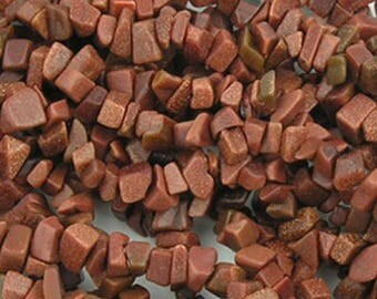 "Goldstone chips, 34"" strand of pre-drilled goldstone chips"