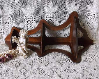 Vintage wood corner shelf, dark wood, time worn scroll cut shelf