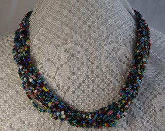 Vintage 15 Strand Multi Colored 20 inch long Necklace of Blue,White,Red, Pink, Yellow and Black Seed Beads