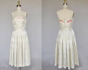 50s wedding dress | vintage 50s creamy ivory sleeveless satin gown | drop waist, pink satin detail