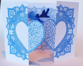 Locking love hearts valentines hand silkscreen printed,  greetings card in blue with blue bird