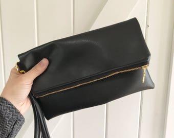 Black on black faux leather clutch