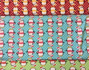 Fabric freedom Christmas Characters collection FF54 Penguins in red, blue or green by the half metre