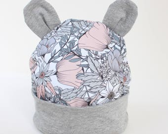 Baby / Toddler beanie hat with ears in sweet floral pattern.