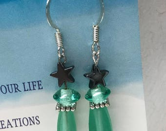 Green glass earrings with hematite star