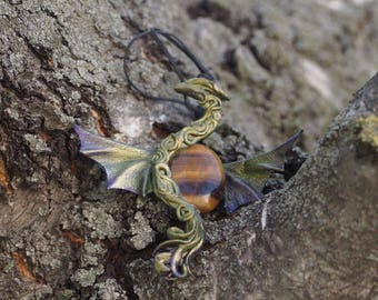 Dragon pendant  with tiger eye gem