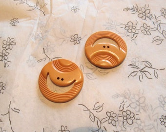 pair of smiley face vintage bakelite buttons