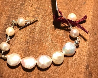 White genuine pearl bracelet with sterling silver toggle clasp.  Matching earrings available!  Check my earrings category or message me!