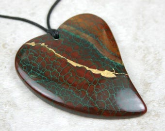 Kintsugi (kintsukuroi) brown agate with green dragon veins curved stone heart pendant with gold repair on black cotton cord - OOAK
