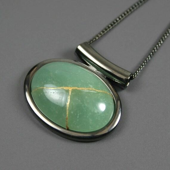 Kintsugi (kintsukuroi) green aventurine stone cabochon with gold repair in a gunmetal plated setting on gunmetal chain - OOAK