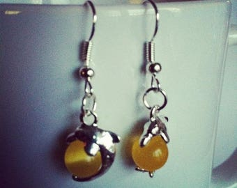 Dolphins yellow glass beads earrings