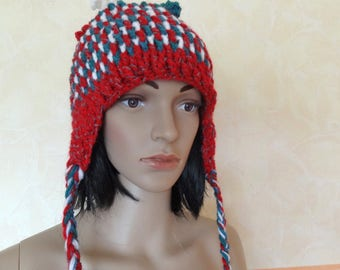 Peruvian hat for women crocheted with white, red and blue/green wool.