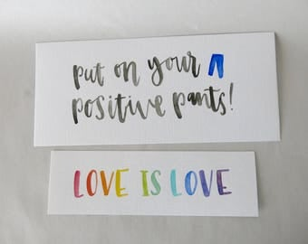 "Set of 2 Original Artwork Watercolor Paintings, ""Love is Love"" and ""Put on Your Positive Pants!"""