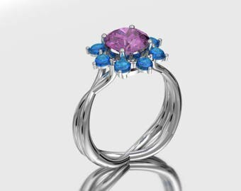 14kt White Gold 8mm Round Tourmaline With 8 - 3 mm Round Swiss Blue Topaz Cabochons In A Halo Setting