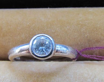 Women's silver solitare and cz ring