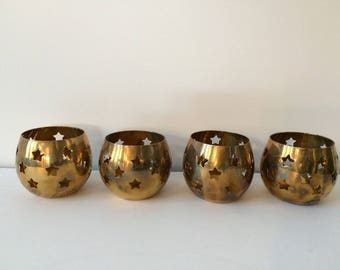 brass votive candle holders / pierced stars