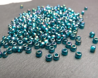 Toho Japanese Glass Round Seed Beads 24 grams 400+ beads, Size 6/0 4mm, Threading hole approx 2mm, Transparent Rainbow Teal