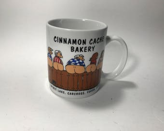 Cinnamon Cache Bakery Souvenir Coffee Mug Spirit Lake Yukon Canada Get Your Buns In Here