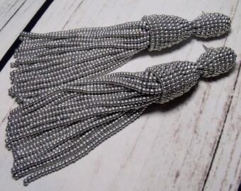 Silver Oscar de la Renta earrings, long tassel earrings