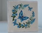 Vintage blue butterfly cross stitch / embroidered wall art / 1970s boho style home decor / butterflies and flowers