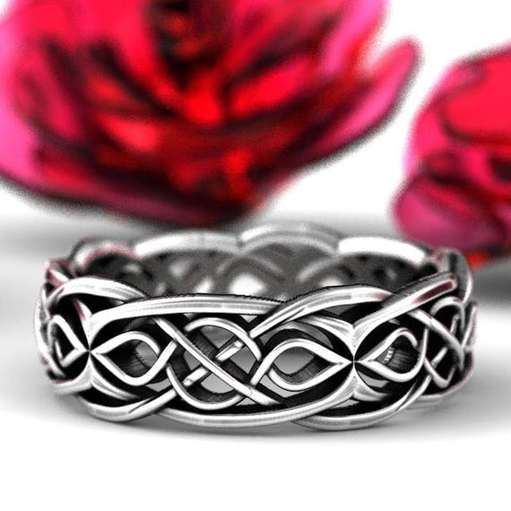 Celtic Wedding Ring With Partial Cut Through Infinity Symbol