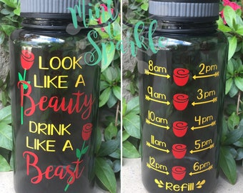 Look like a beauty drink like a beast motivational water bottle with hourly time tracker