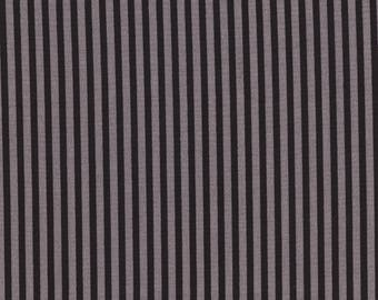 Fabric has grey and black stripes.