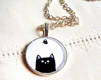 Necklace, silver, cabochon, black cat on a white background.