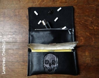 Skull leather tobacco pouch.