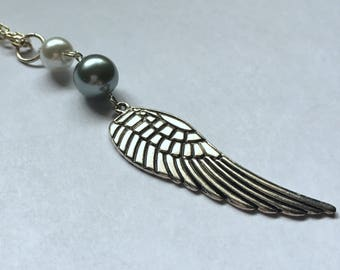 Wing and bead necklace