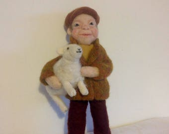 Needle felted farmer with his sheep.