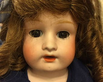 Antique sweet faced bisque/ kid body doll