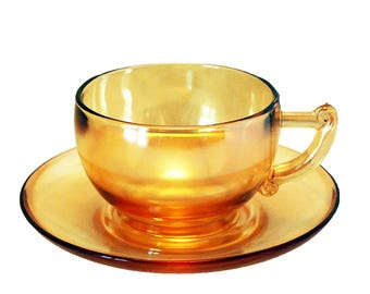 Jeanette Iridescent Marigold Carnival Glass Cup and Saucer