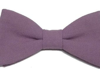Purple bow backed with straight edges